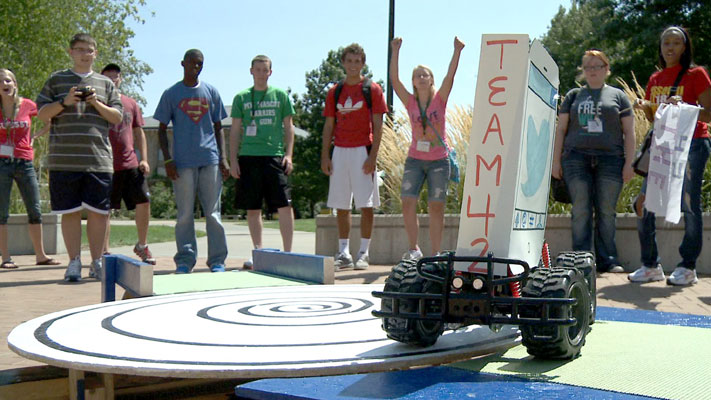 Team 42 cheers its remote-control vehicle during the Project X competition. Photo by Terry Barner