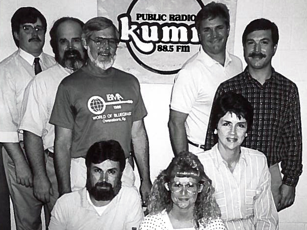 KMST, then known as KUMR, celebrated its first decade on the air in the 1980s. Pictured above on the back row are Scott Dowd, Jim Sigler, Wayne Bledsoe, Lee Buhr and Norm Movitz. Pictured on the front row are Chuck Knapp, Kelly Hughe and Joyce Jella. Three of these staffers – Bledsoe, Movitz and Knapp – still work at the station.