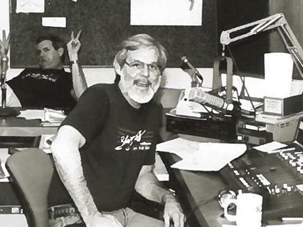 During membership drives, on-air staff work to raise money for the station and build the station's membership – and they have fun doing it, as Wayne Bledsoe (at the microphone) and Lee Buhr demonstrate.