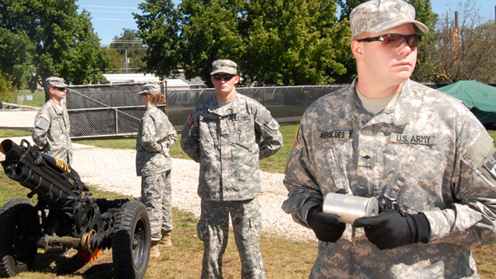 Senior Jordan Verslues (right) leads the Army ROTC's cannon crew. Photo by B.A. Rupert.