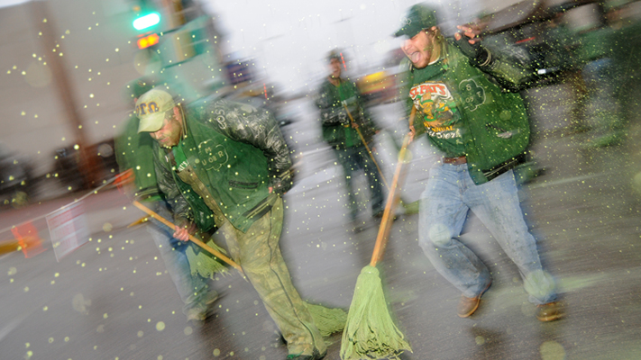 Turning Pine Street green is the job of St. Pat's Board alumni, who gather at 6 a.m. with mops and green paint.