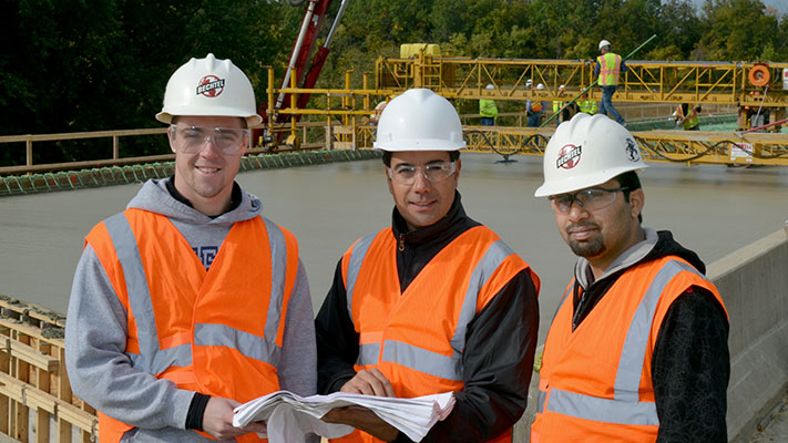 Graduate students (from left) Alex Griffin, Eli Hernandez and Hayder Alghazali took part in all phases of the design and construction of a new highway bridge that uses new longer-lasting concrete beams developed at Missouri S&T. Photo by Terry Barner.