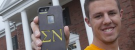 Sophomore Connor Wolk with his engraved iPhone case that sports his fraternity letters. Photo by B.A. Rupert.