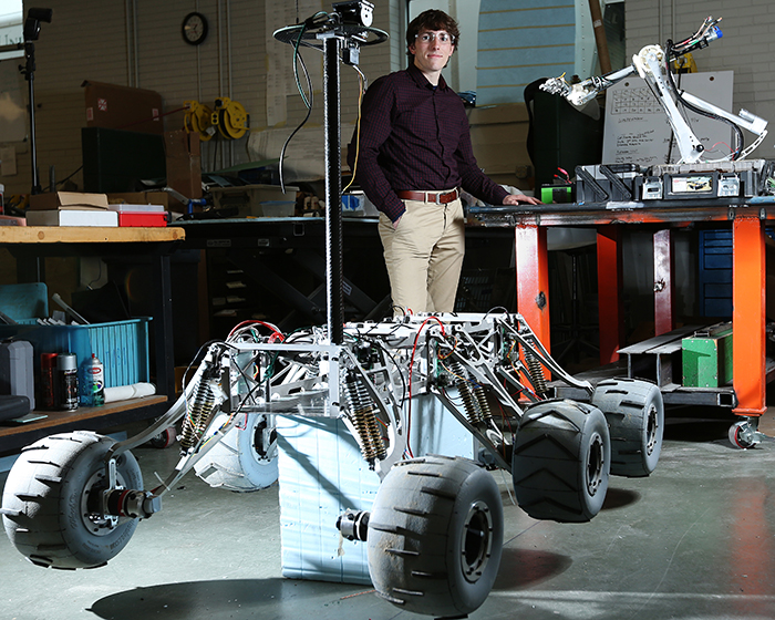 Bopp with the 2014 Mars Rover he helped design and build.