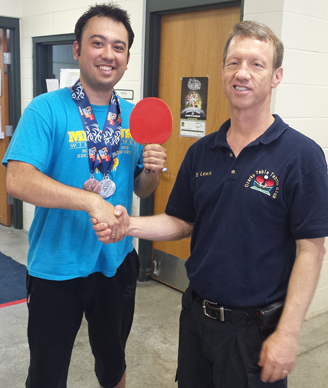 Atmaca with Bill Lewis, president of the Ozarks Table Tennis Club, after winning gold, silver and bronze medals at the Missouri Show-Me State Games. Photo submitted.