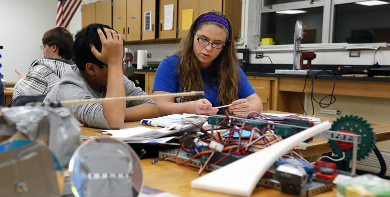 Aysen Malone, a freshman engineering student, mentors a member of one of Rolla High School's FIRST Tech Challenge robotics teams.