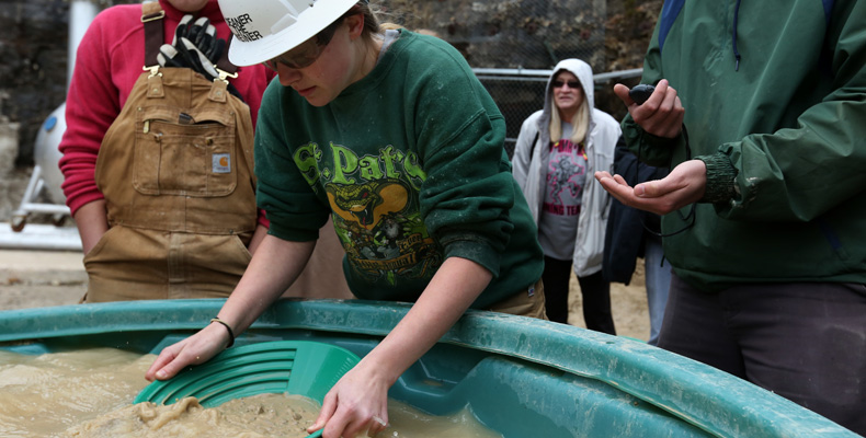 Deanna Fitzgerald, a senior member of Missouri S&T's 2014 world champion women's mucking team, pans for gold during the international Intercollegiate Mining Competition last year at the Experimental Mine in Rolla. This year, the team is traveling a little further — to Kalgoorlie, Australia — to defend its crown.