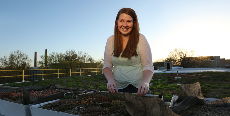 Katie Bartels, a sophomore in environmental engineering, conducts her experiment on the green roof on top of Emerson Electric Co. Hall.