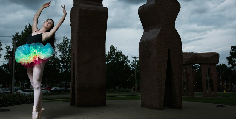 Kailea Tilden dances in front of the Millenium Arch on campus.