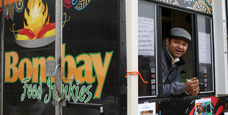 Sid Panchal works the window and serves authentic Indian street food out of his St. Louis-area food truck, Bombay Food Junkies.
