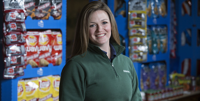 Alumna Catherine Swift, pictured in front of the Frito-Lay display at the Spring Career Fair, is just one of a handful of Miners who work in the company's Topeka, Kansas, plant.
