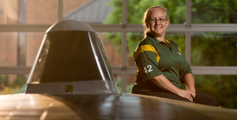Letha Young, a lieutenant with the Missouri S&T police department and advisor to the university's Solar Car Design Team, poses with the team's car.