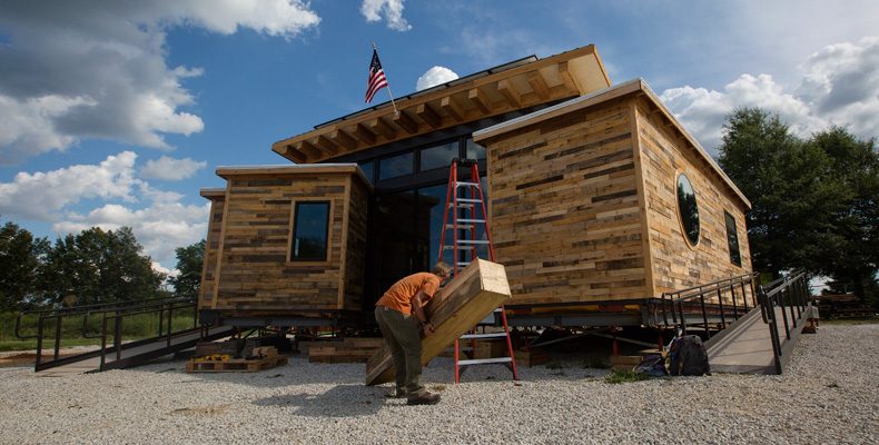 The Nest Home, the Solar House Design Team's entry into the 2015 U.S. Department of Energy Solar Decathlon, receives its final touches before being shipped to Irvine, California, for the competition.