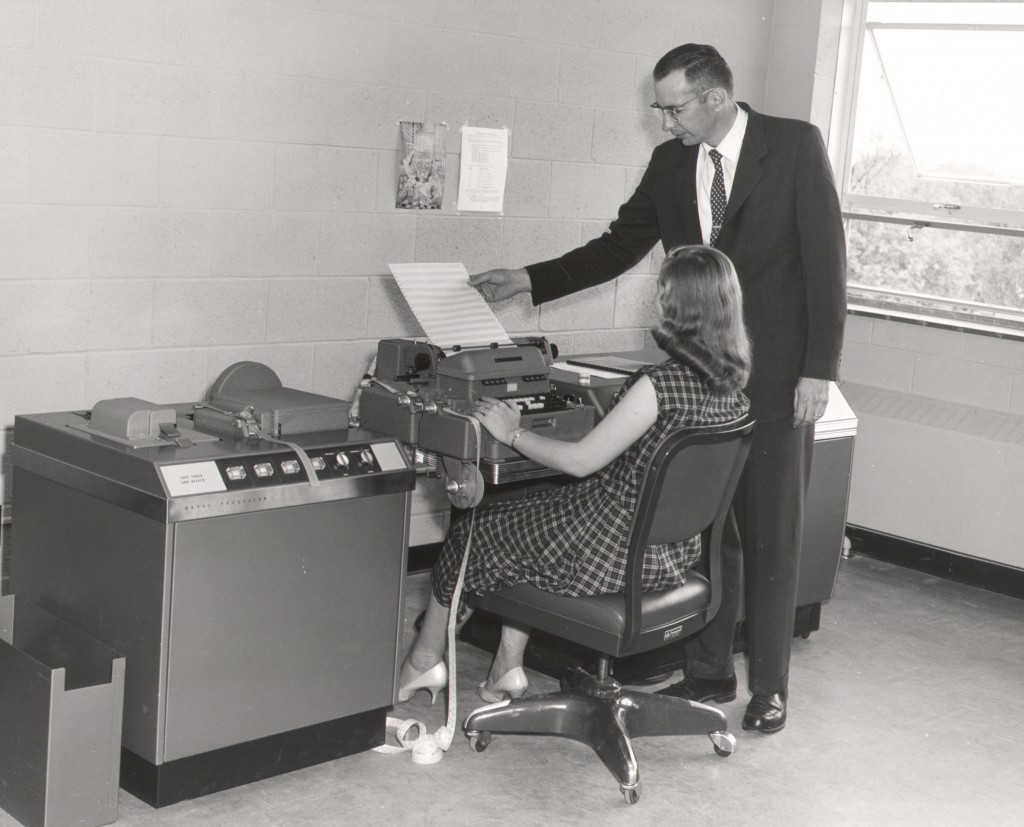 Dr. Ralph Lee, former director of the MSM Computer Center, helps a student operate the university's first computer – a Librascope General Precision, or LGP-30. The computer retailed for $47,000, or about $400,000 in today's dollars and had no memory.