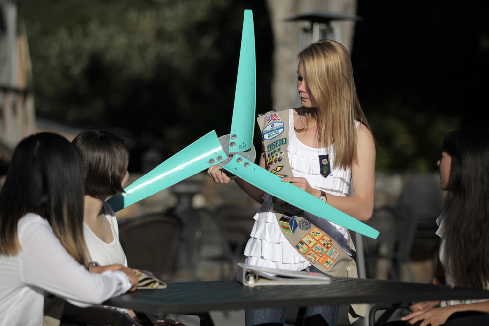 Buenemann shows off her residential-scale wind turbine to fellow Girl Scouts.