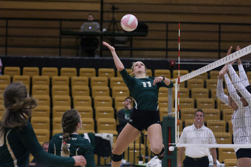Krista Haslag goes up for a hit during a game against the University of Missouri-St. Louis volleyball team on Oct. 3.